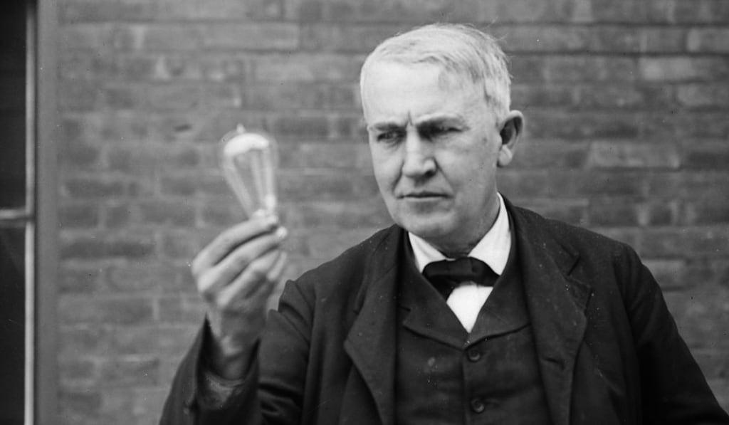 Thomas Alva Edison in 1911 with his famous light bulb